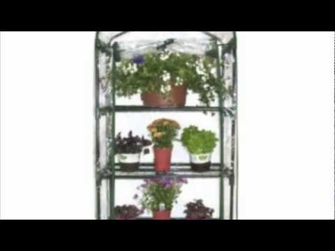 4 tier mini greenhouse with grow lights doovi for Walk in greenhouse big lots