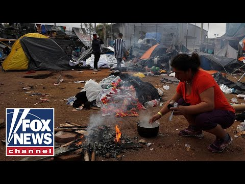 Migrant caravan moved to new site