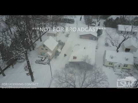 STOCK - 12-30-2017 - St Joseph, MI aerial drone footage of snow fall in city