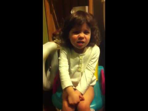 Funny baby trying to poop