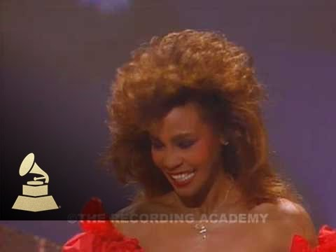 Whitney Houston accepting the GRAMMY for Best Pop Vocal Performance at the 28th GRAMMYs | GRAMMYs