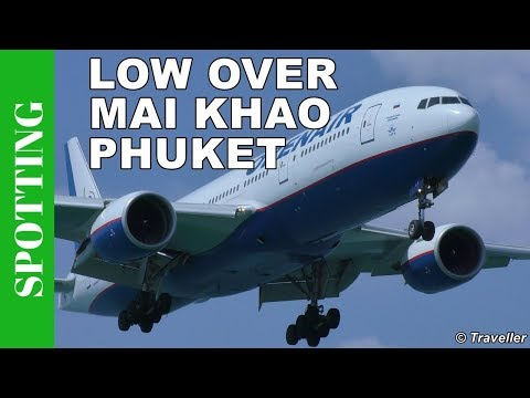 Low landing Orenair Boeing 777 at Phuket Airport  – Mai Khao Beach in Phuket