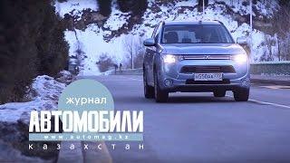 Роман Масленников и Бейбит Алибеков едут на алматинском электричестве за рулем Mitsubishi PHEV
