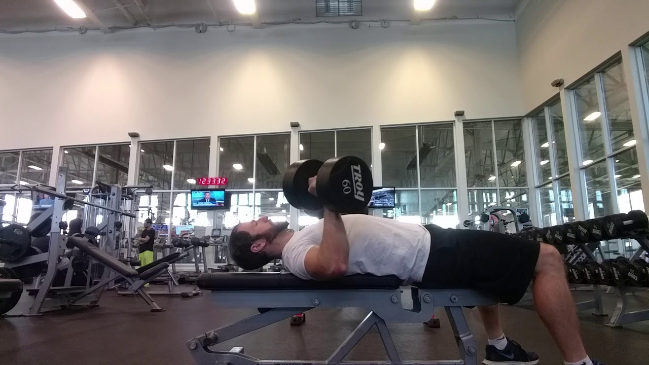 Online Personal Trainer. Chest and arms exercise. Dumbbell