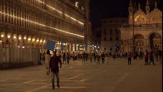 Lively San Marco Square in night Venice, Italy
