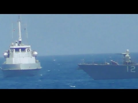 Watch as the US Navy fires warning shots toward an Iranian patrol boat