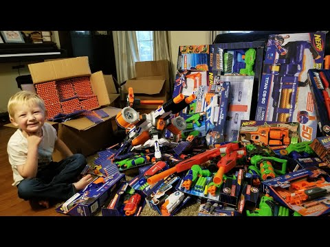 Outdoor NERF WAR 20 vs 20!!! Unboxing 60 guns + 4000 rounds of ammo
