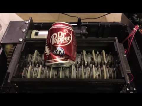 Shredding aluminum cans.
