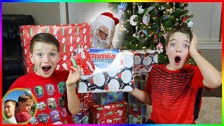 Boys vs Girls NERF BATTLE! Boy's Try to Open Christmas Presents Early!