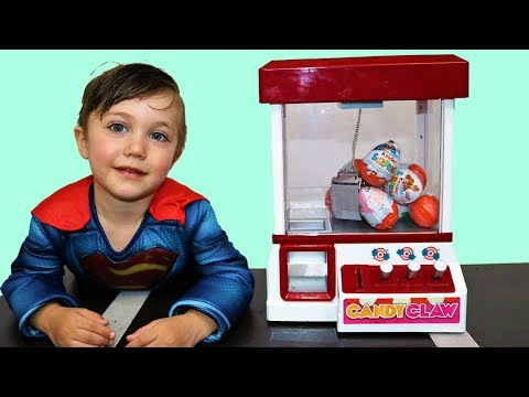 Zack Play with Surprise Eggs Claw Machine and open toys