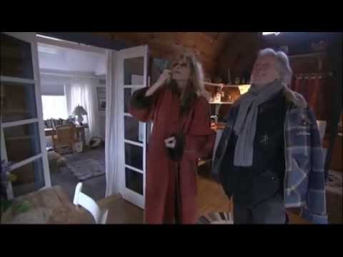 Carly Simon gives Klaus Voormann a tour of The Black Honeymoon Cottage