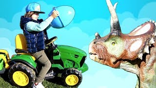 Egg Hunt Surprise Toys Challenge for Kids in Dino Park with Mommy | TimKo Kid Ride on Tractor