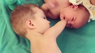 Handless little boy cares for his newborn sibling