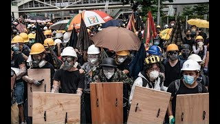 Hong Kong protesters clash with police on China handover anniversary