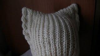 Вязание шапки с ушками на спицах.  Knitting hats with ears on the needles.