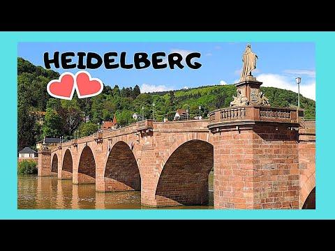 HEIDELBERG, crossing the historic OLD BRIDGE (ALTE BRUCKE) in the MEDIEVAL TOWN (GERMANY)