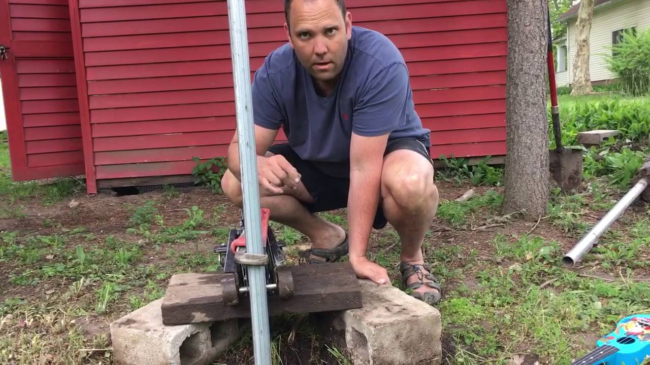 An easy way to remove metal fence posts using items you (likely) already  own