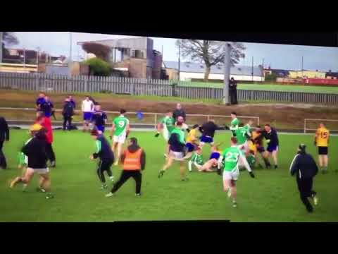 Two teams fight at GAA game (Gaelic Football)