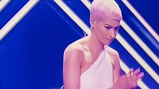 #Eurovision 2018 A man storms the stage during UK's SuRie song #Brexit