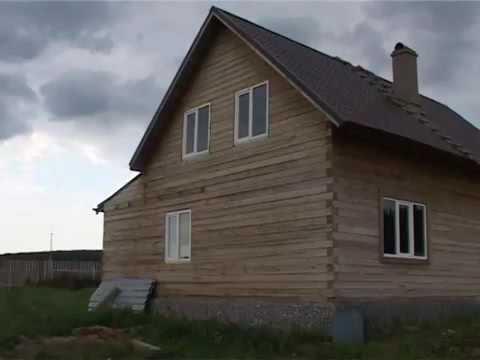 Деревянный дом из бруса с мансардой