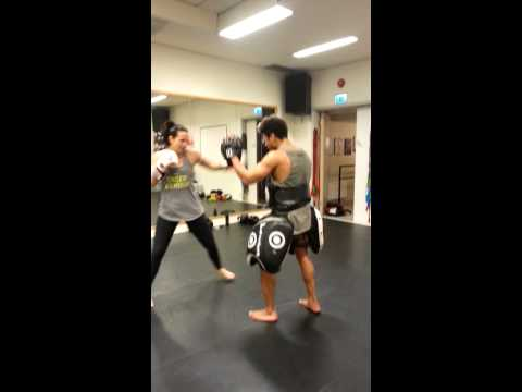 Pad work at 5 star muay thai in Stockholm Sweden