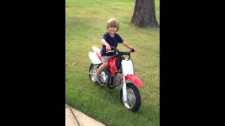 Baylor revving engine on new dirt bike