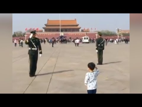 Adorable moment: Chinese boy tails a guard to salute him at Tiananmen Square