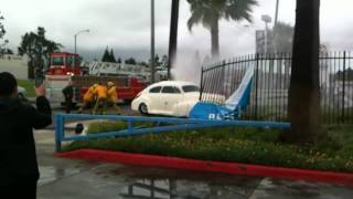 classic car crashes into fire hydrant