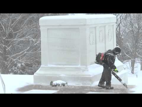 Blowing snow off Tomb of Unknown Soldier archival stock footage
