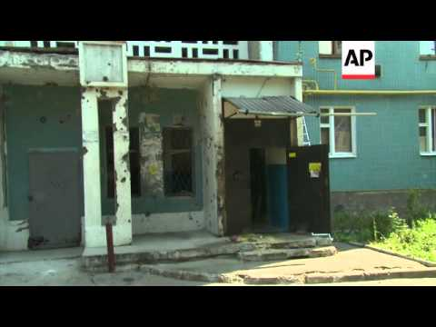 Donetsk council says 2 killed by shelling in rebel-held city; block of flats hit; residents' reactio