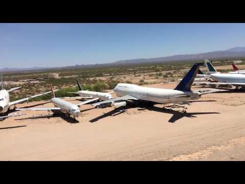 LUH-72 helicopter flies over aircraft boneyard at Pinal AirPark in Arizona