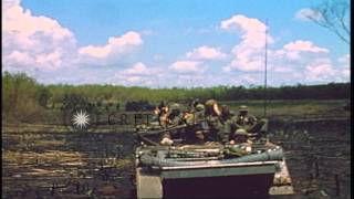9th Infantry Division troops aboard an M113 Armored Personnel Carrier moving thro...HD Stock Footage
