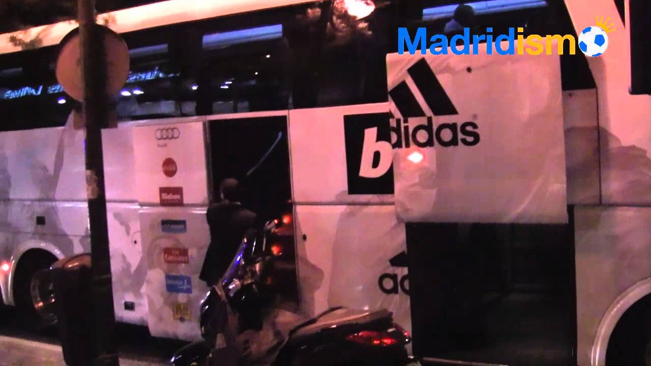 Real Madrid players board the bus on the way to play ...