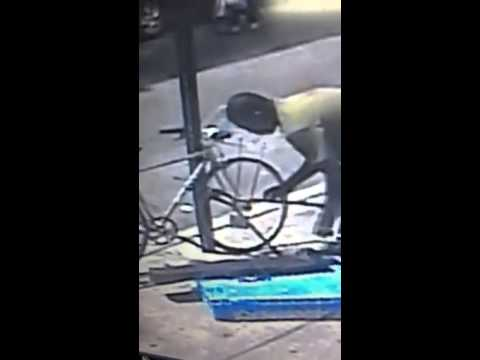 Bike thief with boltcutters chewing on an ABUS BORDO bike lock.