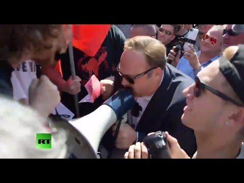 Infowars frontman Alex Jones faces & fights anti-Trump protesters