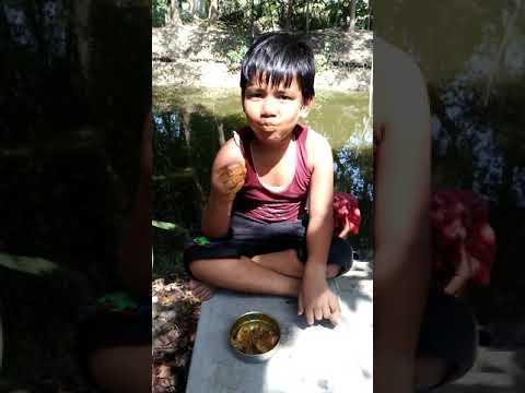 Boy eating his favourite chicken kosha