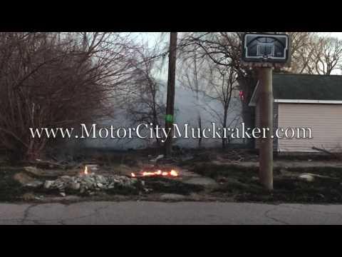 Wind-swept fires tears across Detroit