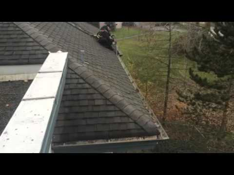 Gutter cleaning harnessed safely to roof