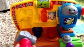 Comparing the Fisher-Price tool bag and tool bench baby toys