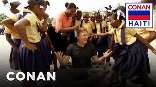 Conan disrupts the learning process and meets the future president of Haiti at Ecole Nouvelle Zoranje in Port-au-Prince.  More CONAN @ http://teamcoco.com/video  Team Coco is the official YouTube channel of late night host Conan O'Brien, CONAN on TBS & TeamCoco.com. Subscribe now to be updated on the latest videos: http://bit.ly/W5wt5D  For Full Episodes of CONAN on TBS, visit http://teamcoco.com/video  Get Social With Team Coco: On Facebook: https://www.facebook.com/TeamCoco On Google+: https://plus.google.com/+TeamCoco/ On Twitter: http://twitter.com/TeamCoco On Tumblr: http://teamcoco.tumblr.com On YouTube: http://youtube.com/teamcoco  Follow Conan O'Brien on Twitter: http://twitter.com/ConanOBrien