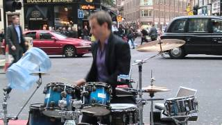 Amazing street drummer playing and dancing as a robot!