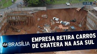 Empresa retira carros de cratera na Asa Sul   SBT Brasília 12/12/2019