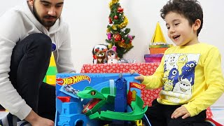 Yusuf and Uncle open Christmas Presents