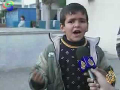 A Palestinian boy talks about his suffering during the Israeli war on Gaza