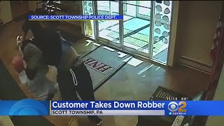 63 year old man takes down bank robber