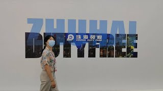 GLOBALink Exploring duty free shopping area at 1st China Int l Consumer Products Expo