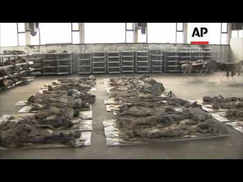 Hundreds of bodies excavated from mass grave 18 years after the war