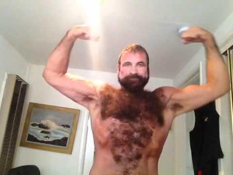 Hairy muscle guy flexing