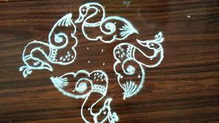 Simple rangoli designs...swans..8 to 2 dots