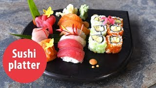 Japanese sushi platter with California maki, Nigiri and Sashim